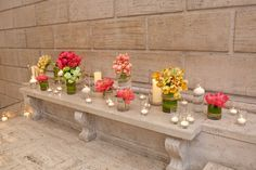 Flowers and candles provide ambiance on the grand staircase to Samsung Hall at the Asian Art Museum. #mccallssf #mccallscatering #mccallsfloral #asianartmuseum #eventdecor