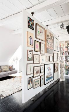 [The ceiling is like we had in Anaheim. White in some rooms, brown in others. I loved those ceilings.]  Love the picture wall idea