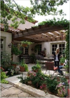 Enjoy A Home Sanctuary Of Stone, Plants, And Wood With A Simple Pergola  Design.