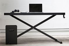 KiBiSi's Xtable is adjusted by hand crank. A flexible desk for a functional yet minimal work space,