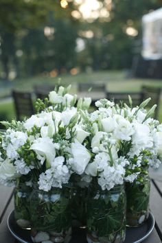 white blooms in simple jars - Lisianthus and Phlox I think  @Rita Entrekin