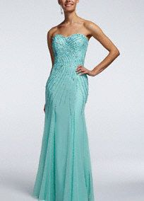You will shimmer and shine like a star all night long in this stunning prom dress!  Strapless all over beaded bodice with sweetheart neckline is sure to gleam and catch the light.  Long and soft mesh silhouette is sexy, sleek and comfortable.  Fully lined. Back zip. Imported polyester.  Dry clean only. Do not use Perchlorethylene Solvent. Do not spray Alcohol based products such as perfume or hairspray directly on garment.