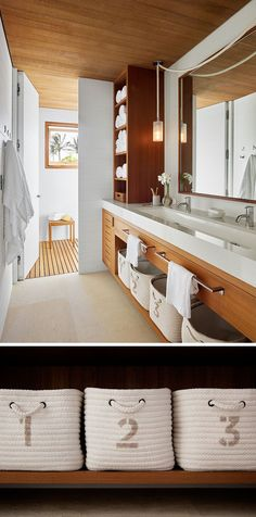In This Modern Beach House Bathroom A White Countertop With Long Trough Sink Sits