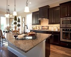 model home kitchen with brown cabinets - Google Search