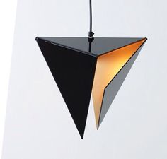 Triangular lamp, metal sheet and warm light