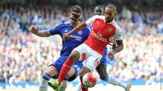Gary Cahill tried to challenge Theo Walcott for the ball at Stamford Bridge. Photo by Arsenal.com.