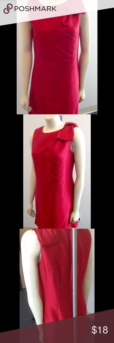 Red satin dress with bow detail, perfect for party Such a simple luxury dress. Bought for a party and then chose a different dress.  Never worn...just like new.  Tag is out, but believe it's a Calvin Klein. Dresses