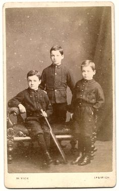 Carte de visite of three boys, probably brothers, with one holding a cricket bat. By W. Vick of Ipswich.