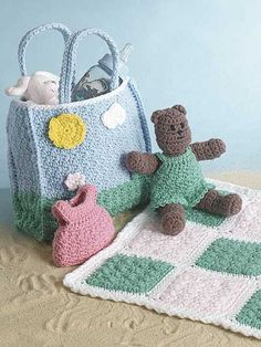 Darling tote & teddy with outfits and matching blankie are crocheted with medium (worsted) weight yarn and sizes G and I hooks.