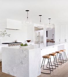 Bright white modern kitchen https://emfurn.com/collections/bar-stools