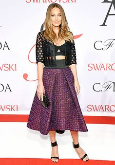 Hannah Davis flashed a peek at her abs in a black Milly bra top, which she paired with a lace jacket and an amethyst, A-line skirt by the house. She accessorized the look with a small black clutch and sandals.