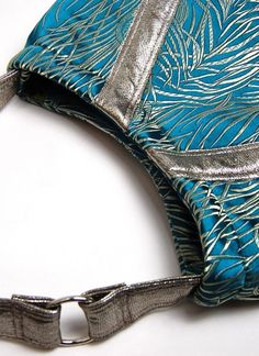 The luxurious feel of Italian leather and silk make this roomy bag a perfect everyday bag. • Color scheme; turquoise, silver, olive  photo 2/3