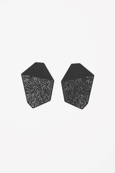 Add some edge to your party style with COS | Laser-cut earrings