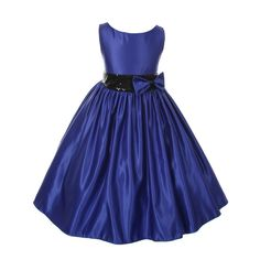 Your girl will look amazing in this special occasion flower girl dress by Kiki Kids. This stylish satin royal blue dress features a boat neck, a flared skirt, a bow and a black sequin accented waistline. It is sleeveless and has a ribbon bow at the back a
