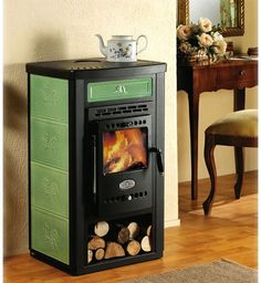 Tiny and stylish wood burning stove with heating plate for a small home.