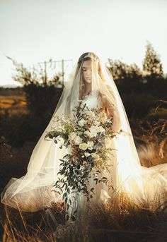 Bride's gown: Caroline Campion/ Headpiece & veil: Anna Marguerite - Moody & romantic winery wedding inspiration by Balencia Lane (Stylist) + The Love Collective (Photography) - via Magnolia Rouge (Floral design: Perfect Style)
