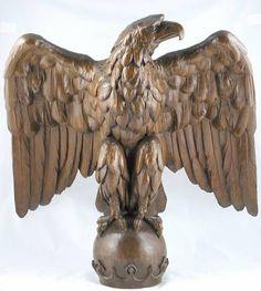 "Carved Oak American Eagle atop a Sphere. Circa 19th Century. 23"" x 23"" x 16""."
