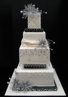 Very elegant cake with in black and white with silver bling.  Very unique design..love it!  ᘡղbᘡ