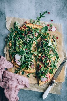 Chickpea pizza crust with spring greens and asparagus, vegan and gluten-free