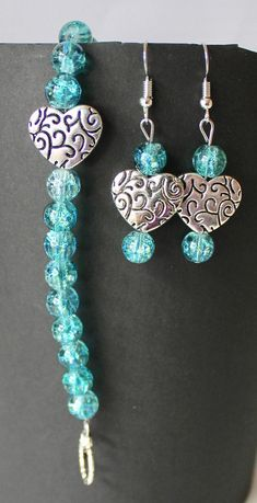 This is a handmade turquoise crystal and stainless steel heart accent bead bracelet and earrings set. Total bracelet length is approximately 7.5 inches with a toggle clasp. Total earrings length is approximately 2.25 inches with a french wire hook.