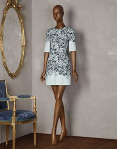This pale blue Dolce & Gabbanashort dress with lace print is perfectly pretty for the races.