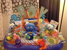 Baby shower arrangement by Goodies Gift Arrangements