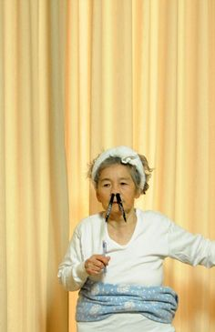 Kimiko Nishimoto learned how to use a camera for the first time at the age of 71. She has a series of hilarious self-portraits involving random costumes and staged falls.