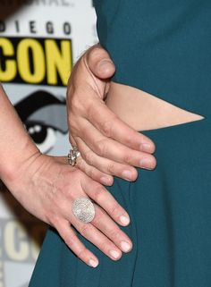 """Actress Emilie de Ravin, jewelry detail, attends the """"Once Upon A Time"""" press room during Comic-Con International 2015 at the Hilton Bayfront on July 11, 2015 in San Diego, California."""