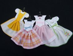 DIY Hanky Dress Pattern 103 104 by HankyDresses on Etsy, $10.00 She cuts the bodice and decorates w/pens, paint, or pencils, and uses double sided tape, hole punch, card stock and little hangers that her husband makes. Would be cute w/vintage hankies.