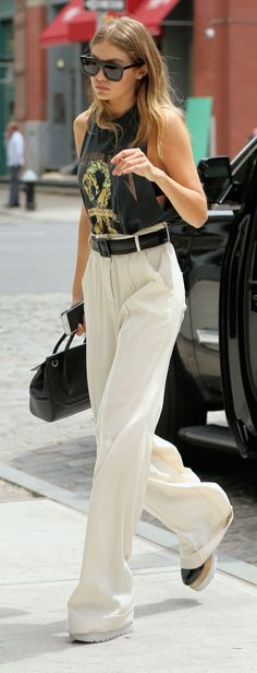 Gigi Hadid wears a pair of loose, flowy pants that would drown most people. But paired with a casual Metallica t-shirt and Stella McCartney shoes, the model creates the perfect high-low look.