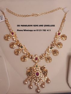 Stunning gold necklace with lakshmi devi kasu hangings. Necklace studded with multi precious stones. They make on orders also in minimum time get best finishing at wholesale prices. Visit or call on 8125 782 411 for orders. Jewelry Design Earrings, Gold Earrings Designs, Gold Jewellery Design, Necklace Designs, Jewellery Box, Pendant Jewelry, Jewelry Rings, Gold Wedding Jewelry, Bridal Jewelry