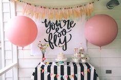 """Giant pink balloons flank the main table from Modern Glam """"You're So Fly"""" Birthday Party at Kara's Party Ideas. See all the details here!"""