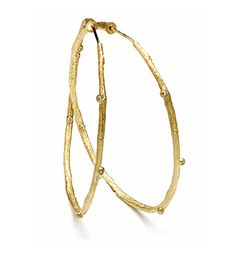 """A stunning pair of earrings. Our endless large branch hoop earrings with diamond pod accents (0.10 cttw) epitomize the """"bohemian chic"""" look.  Hoops measure approximately 2"""" in diameter."""