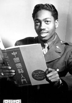 Pvt. Lloyd A. Taylor, 21-year-old transportation dispatcher at Mitchel Field, New York City, who knows Latin, Greek, Spanish, French, German, and Japanese, studies a book on Chinese. A former medical student at Temple University, he passes two hours a day studying languages as a hobby
