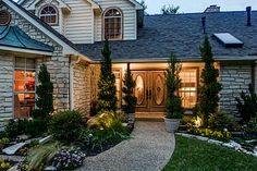 Another beautiful yard with matching beautiful double front door.