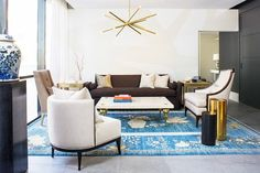 Traditional and modern furniture on Persian blue rug // Reagan Hayes Showroom Los Angeles