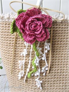 Like this idea for crochet Rose corsage for bag.