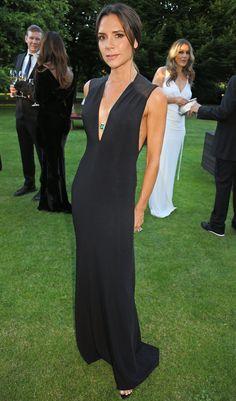 Victoria Beckham in a plunging black dress