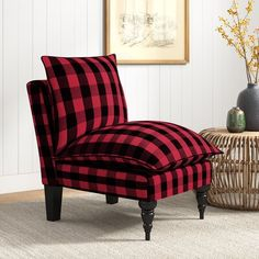 This slipper chair adds a farmhouse touch to your living room or bedroom, and is sure to complement coastal and traditional homes. It's built with a solid pine wood frame and features turned front legs and a sleek armless silhouette. The 100% cotton upholstery is decorated with a bold plaid pattern that's reminiscent of your favorite flannel. This lounge chair has a pillow-like seat and back cushion that's filled with foam, and there's springs in the seat for just the right amount of support. Up Traditional Homes, Cushions, Pillows, Solid Pine, Plaid Pattern, Slipper, Flannel, Accent Chairs, Coastal