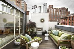 Beautiful roof deck with an industrial feel. (The Time-Traveling Townhouse via New York Magazine)