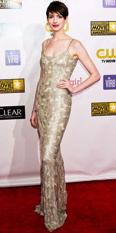 01/11/13: The always-glowing star was at her most radiant in a slinky metallic dress. #AnneHathaway #lookoftheday