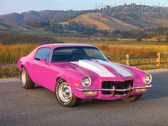 1973 Chevrolet Camaro Pink And White Stripes 3/4 Front View On Pavement By Hills - Kimballstock