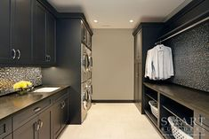 Love the deep grey color and double washer dryer idea