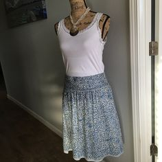 Beautiful Skirt(American Eagle- Beautiful blue watery looking skirt from American eagle size 12. Has a side zipper and is fully lined American Eagle Outfitters Skirts Midi