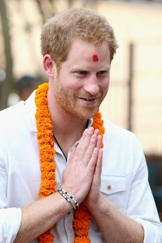 Pin for Later: Prince Harry Is Covered in Paint and Flowers During His Stunning Visit to Nepal