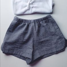 Brandy Melville Black and White Shorts Brandy Melville black and white shorts, never worn. NWT. Perfect condition, super cute ! Have pockets PRICE FIRM  I'm trying to make my money back and I'm not even making all of it back with the price listed, please respect this no offers or lowballs.... Brandy Melville Shorts