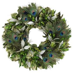 Preserved myrtle and leaves wreath with peacock feathers in a natural twig base.  Product: WreathConstruction Materi...