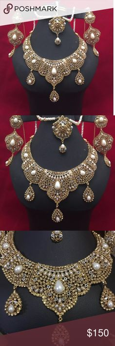 NWOT jewelry set Beautiful NWOT  extremely high quality Polki kundan  bridal  jewelry  set with choker necklace, attached with Pearl beads crystal beads long earrings,.  And matha Patti . jewelry set Attached Rhinstones , crystals beads and pearl beads . Picture took in different lights to show the actual color Very beautiful in front .   All sales are final no return or exchange accepted . Jewelry Necklaces