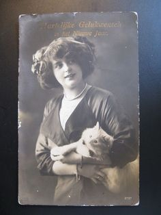 Vintage Old Postcard Young lady with a cat...1917