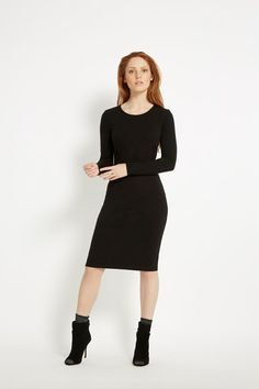 Long-sleeved round neck dress with stretch. Zippers at the sleeves and back neckline add a little edge to this classic black dress. Elle is 5'7 and is wearing a size 10.